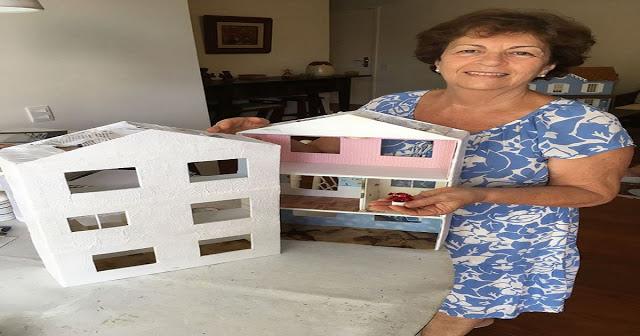 Dona Alice constrói casinhas de papelão para presentear crianças