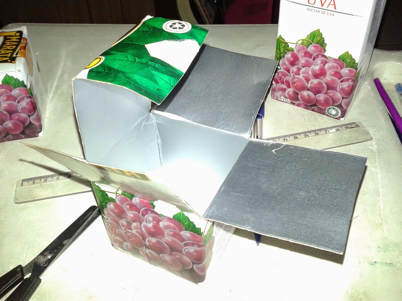Jogo Pedagógico Cubo Silábico feito com caixas de suco: Reciclagem